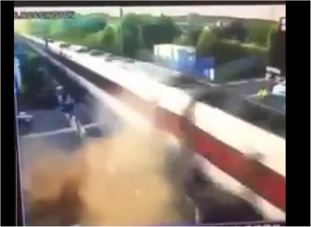 The car is enveloped in a cloud of dust and debris after colliding with a high speed train.