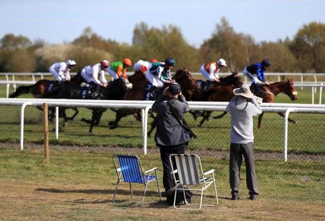 Spectators watch the runners and riders at Doncaster. Photo: Mike Egerton - Pool / Getty Images