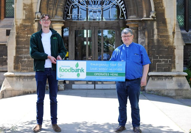 John Parr, Doncaster's Trussell Trust Food Bank Project Manager, pictured with Revd Capt Chris McCarthy, Vicar at St James Church. Picture: NDFP-08-06-21-StJamesFoodbank 2-NMSY