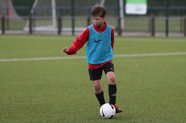 Bryan playing football.