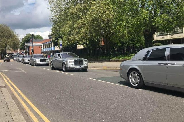 The funeral procession makes its way along Chequer Road
