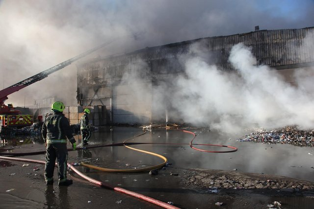 Fire crews have been working around the clock to tackle the fire at Morris Metals. (Photo: SYFR).