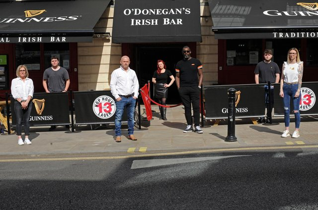 Chris Coughlan, O'Donegan's owner and Ian Bailey, Mason Arms owner, pictured with staff members. Picture: NDFP-30-03-21-O'Donegan's 1-NMSY