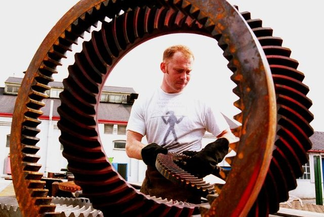 Micheal Bunn at work on his sculpture which was based at Carr Hill in 1996.
