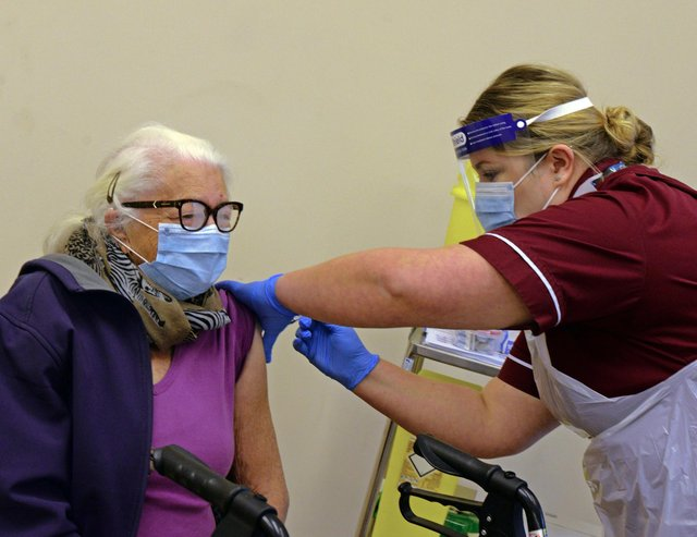 Ann Duggan, is the first to recieve the Covid-19 Vaccination in Doncaster. Picture: NDFP-15-12-20-CovidVaccine 4-NMSY