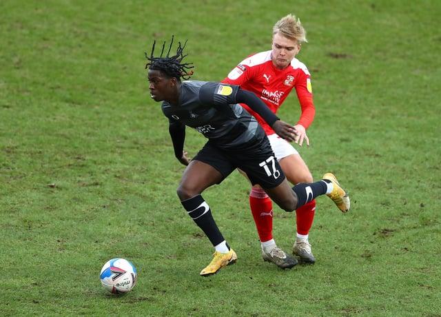 Matt Smith in action against Rovers for Swindon Town last season