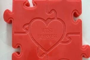 The wax melts read 'Autism Awareness.'
