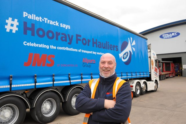 Neil Woodcock, a driver with JMS Transport, with his #Hooray for Hauliers trailer