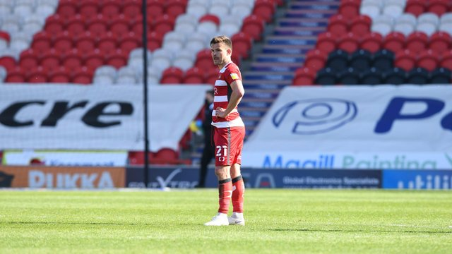 Andy Butler cuts a lonely figure after the defeat to Fleetwood. Picture: Howard Roe/AHPIX