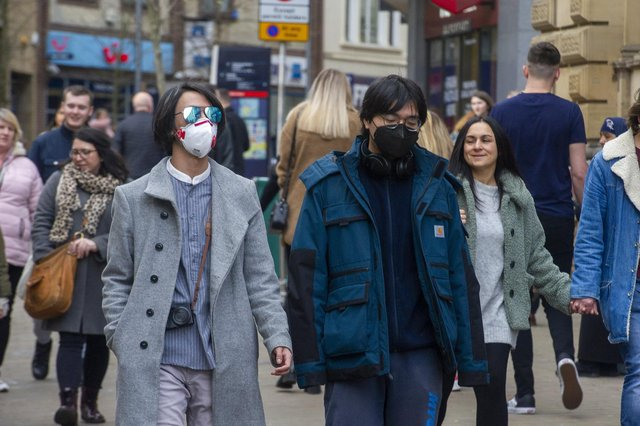 Shoppers take precautions after the outbreak of coronavirus. Picture Tony Johnson.