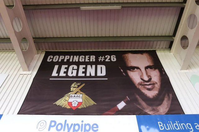 The 'Coppinger Legend' banner at the Keepmoat Stadium. Photo: George Wood/Getty Images
