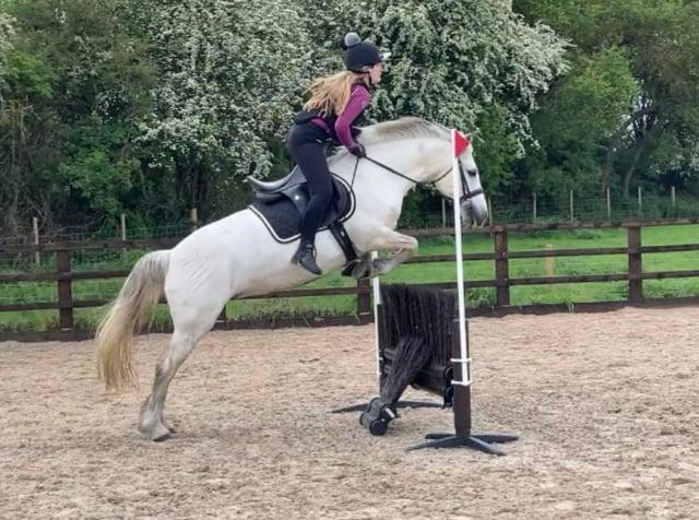 Alyssia enjoys her riding lesson.
