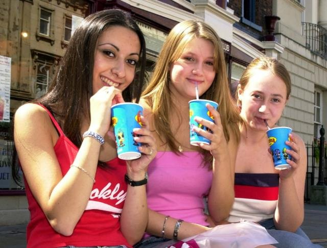 Three teens enjoying a cold drink on a summer day in 2003.
