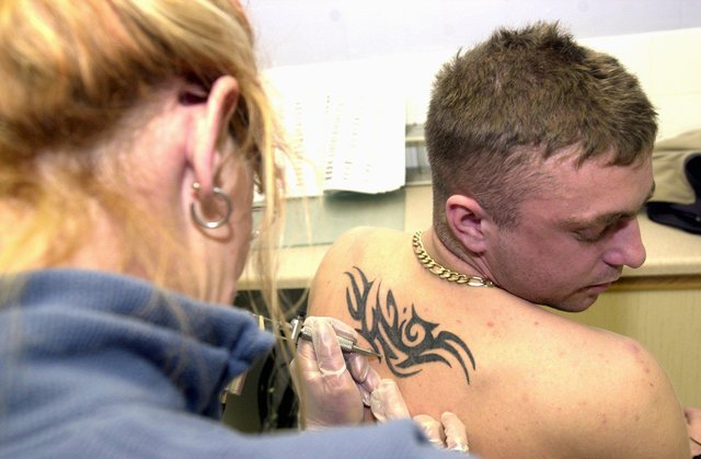 Tattooist Sue Beardmore, of Babylon Tattoo, Nether Hall Road, Doncaster, is pictured at work on client Ian Stevenson, of Intake, Doncaster in 2002
