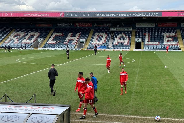 The Rovers squad leaves the field after the warm-up at Rochdale