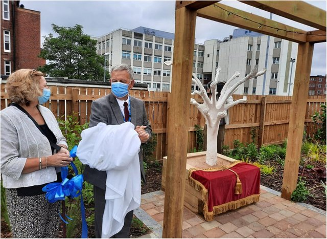 Diane Smith and Richard Parker unveil the new Rainbow Garden at DRI.