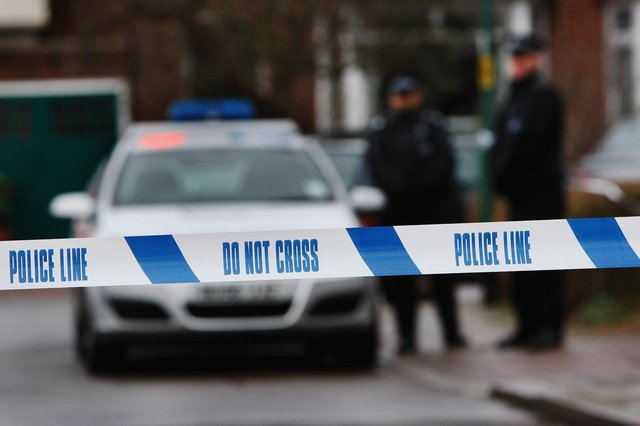 Police tape is pictured   (Photo by Daniel Berehulak/Getty Images)