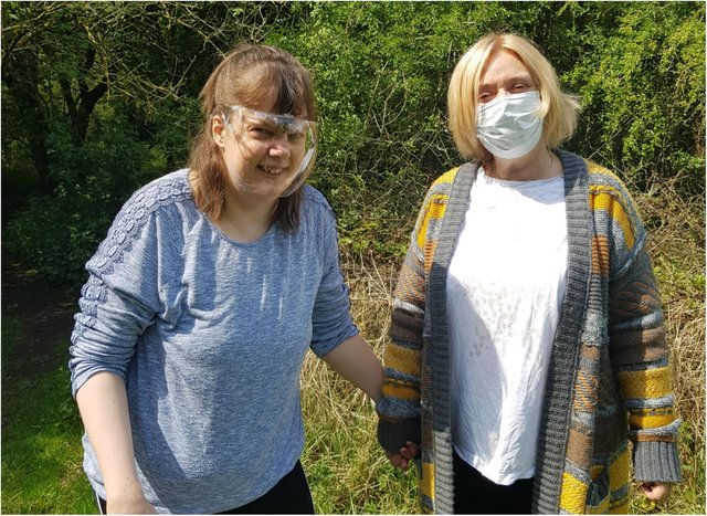 Laura Turner from RMBI Home Harry Priestley House, in Thorne, enjoys a walk in the park with her mum Lesley Booth.