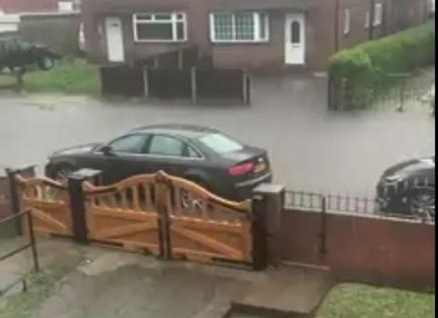 PIcture shows flash flooding in Adwick last night