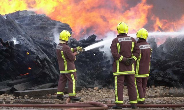 File picture shows South Yorkshire fire fighters fighting a blaze
