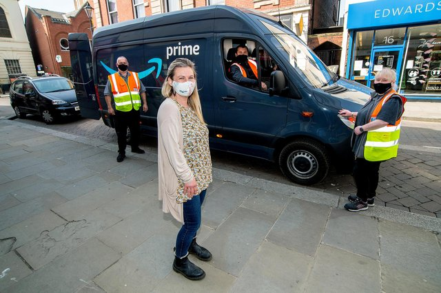 Amazon staff make a delivery of donations to Phoenix WoMens Aid, Doncaster. Amy Tyman, from Phoenix, is pictured with Amazon staff driver Adrian Lisman, Sharron McMinn and Andrew Burdett
