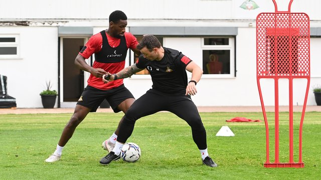 Omar Bogle, pictured with Rovers assistant boss Noel Hunt, has been one of the players to have impressed Richie Wellens the most this week
