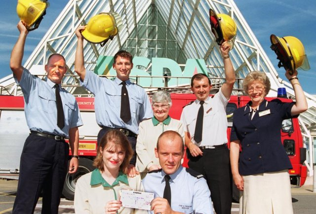 Checkout girl Jane Proctor presented a cheque for £100 to Andy Eaton  to help fund a victim support unit back in 1997