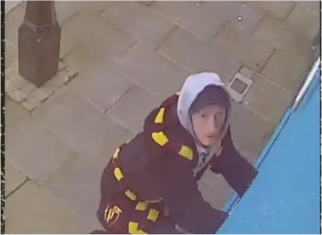 The moment a brazen thief dressed in a Harry Potter dressing gown was filmed swiping a CCTV camera.