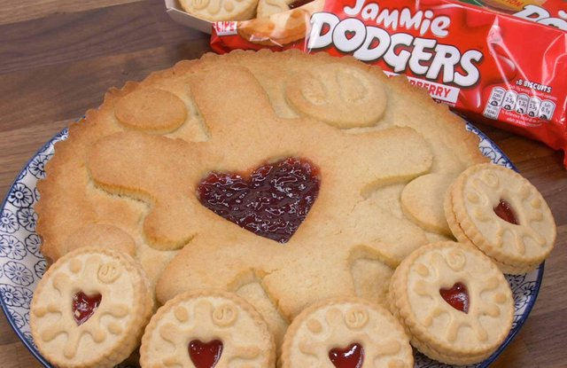 The giant Jammie Dodger - and how it sizes up to the shop-bought biscuit. Picture: B&M.