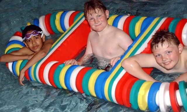 Three boys having fun at Adwick Leisure Centre's pool in 2005.