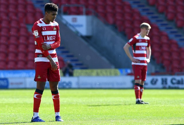 Rovers players after conceding a goal against Fleetwood