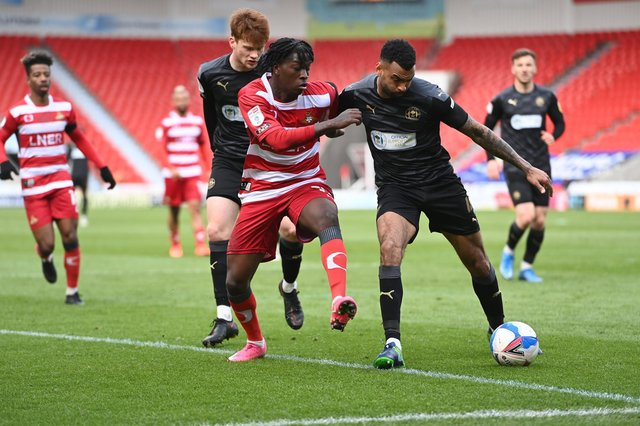 Taylor Richards tries to get the better of Wigan's Curtis Tilt. Picture: Howard Roe/AHPIX
