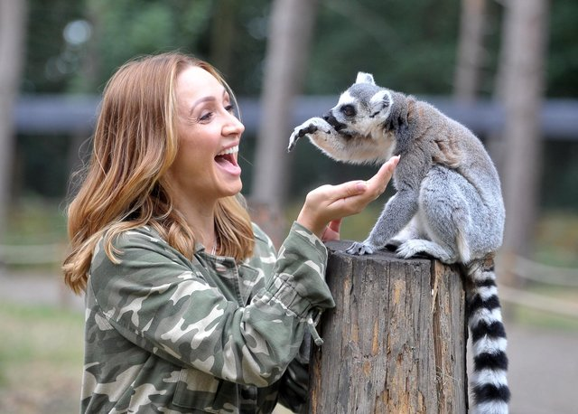 14 August 2018     Actress Lucy Jo Hudson amongst the lemurs during filming the Big Week At the Zoo at Yorkshire Wildlife Park . Picture Tony Johnson.