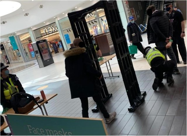 Police arrested a woman in the Frenchgate Centre who was carrying two large knives.