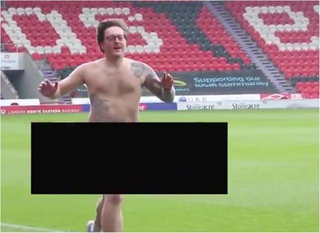 Daniel runs naked around the Keepmoat Stadium.