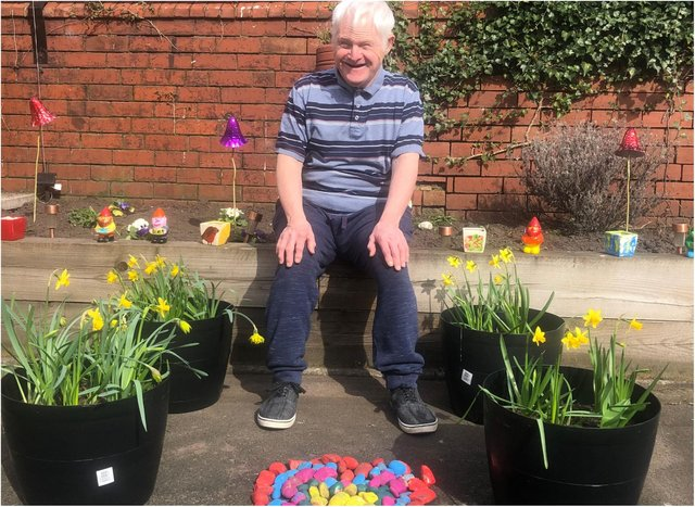 David Jepson of Harry Priestley House with the donated flowers.