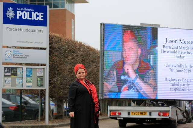 Claire Mercer marked her late husband's birthday by arranging a giant mobile screen to be outside South Yorkshire Police's headquarters calling on the force to prosecute Highways England over smart motorways. Picture: Chris Etchells