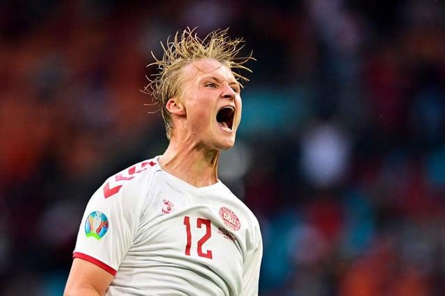 Denmark's Kasper Dolberg celebrates scoring against Wales. Photo by Olaf Kraak - Pool/Getty Images