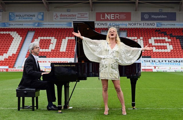 Rachael Wooding pictured performing on the pitch at the Keepmoat Stadium, with Pianist John G Smith. NDFP-27-04-21-LiveMusicReturn 1-NMSY