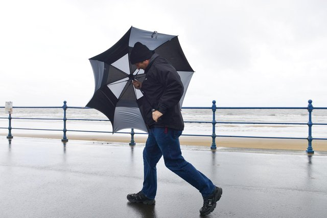 Fighting the high wind coming off the sea at Seaton Carew .Picture by FRANK REID