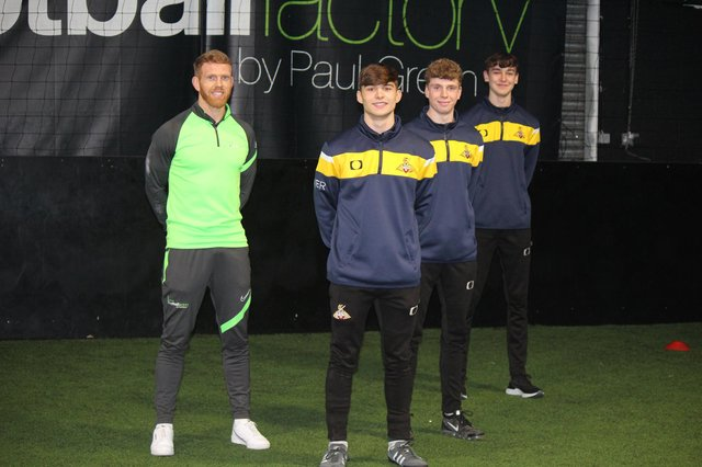 Former Doncaster Rovers midfielder Paul Green with new club scholars Josh Lindley, Tom Parkinson and Alex Fletcher.