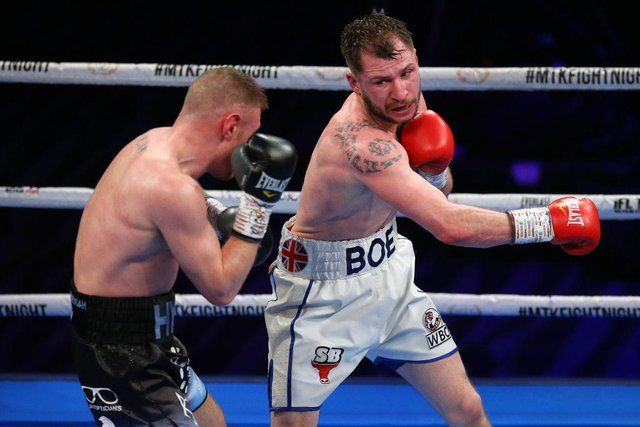 Maxi Hughes throws a right shot at Paul Hyland Jnr during their British Lightweight title fight at University of Bolton Stadium. (Photo by Alex Livesey/Getty Images)
