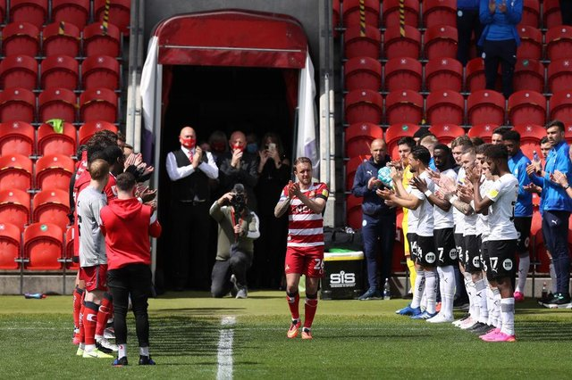 James Coppinger walks out to a guard of honour. Photo: George Wood/Getty Images