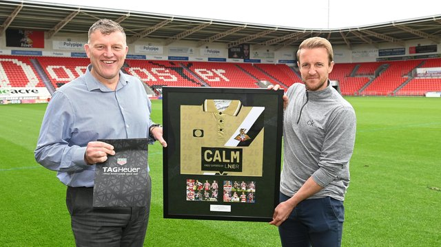 James Coppinger receives tokens of appreciation for his playing career from Doncaster Rovers CEO Gavin Baldwin