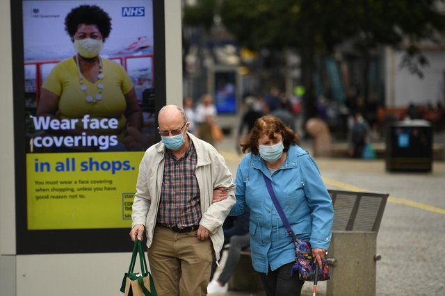 Anyone caught breaking the new coronavirus laws could be fined up to £10,000 (Photo by OLI SCARFF/AFP via Getty Images)