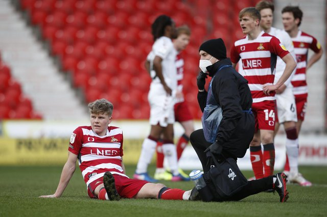 Scott Robertson receives treatment during the clash with Northampton. Picture: Ed Sykes/AHPIX
