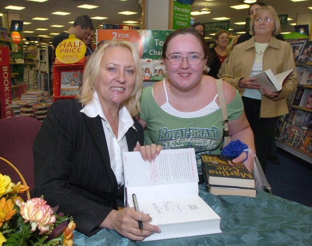 Pictured at W H Smiths, Meadowhall, where writer Martina Cole was seen signing copies of her book The Take. With her is fan Maria Oflaherty from Wincobank, Sheffield.